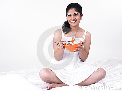 Asian woman enjoying her salad