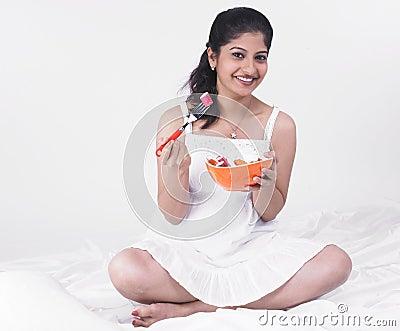 Asian woman enjoying her salad