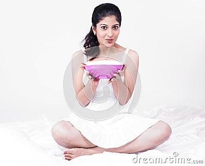 Asian woman enjoying her soup
