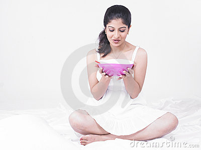 Asian woman enjoying her soup