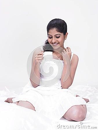 Asian woman enjoying her tea