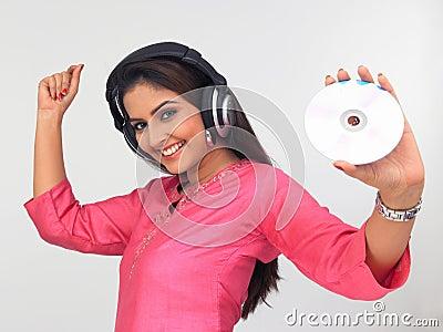 Asian woman enjoying music