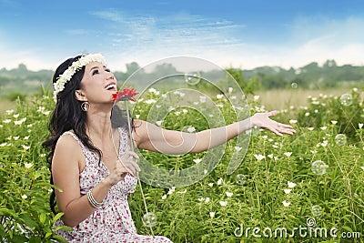 Asian woman enjoying Summer