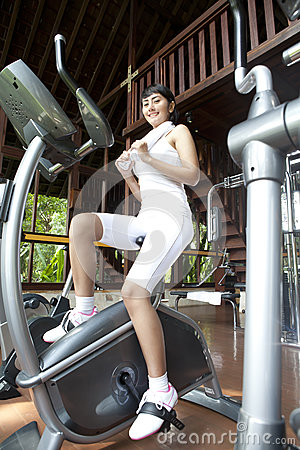 Asian woman exercising at home