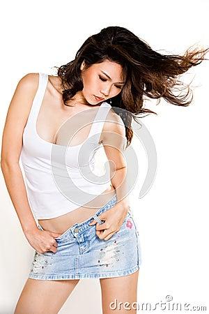 Asian woman flipping her hair