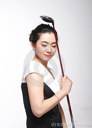Asian woman golfing