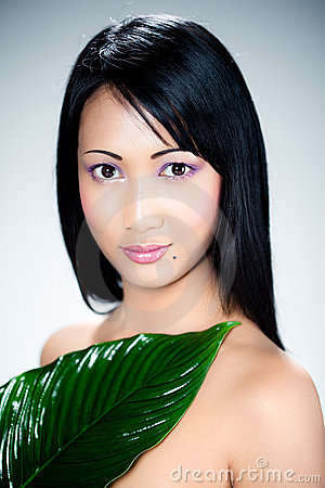 Asian woman with green leaf