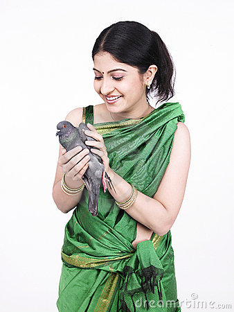 Asian woman with a grey dove