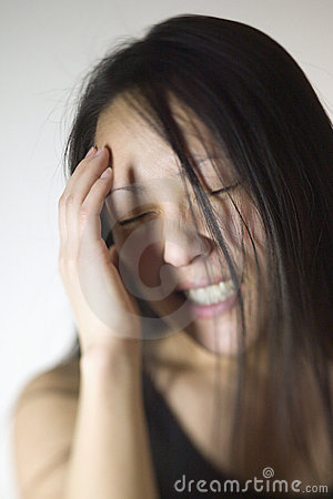 Asian woman with a headache