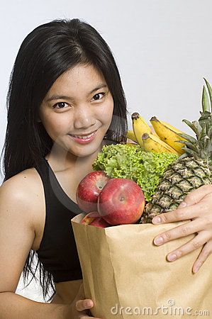 Asian woman with healthy fruits and vegetables