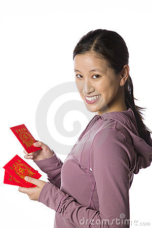 Asian woman holding lai see packets