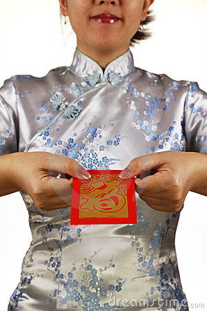 Asian woman holding red money packet or ang pow