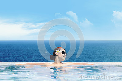 Asian woman in infinity pool