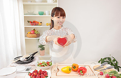 Asian woman in kitchen with space for copy