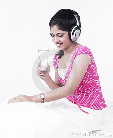 Asian woman listening to music