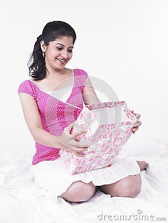 Asian woman looking at a gift bag