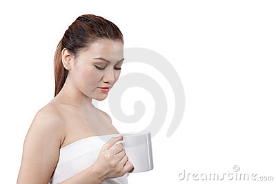Asian woman looking at her cup