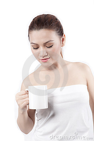 Asian woman looking at her cup and smiling