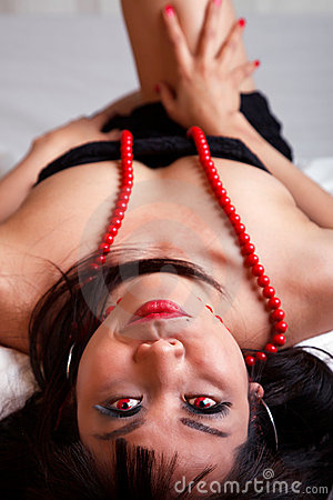 Asian woman lying down