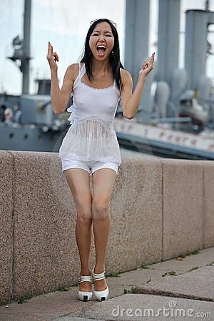 Asian woman near wall