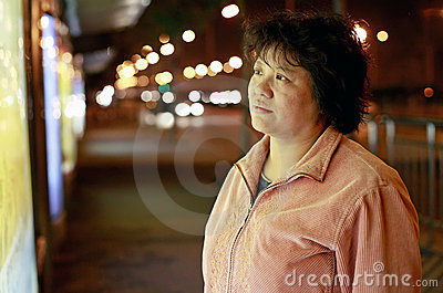 Asian woman at night