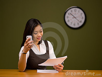 An asian woman paying bills online
