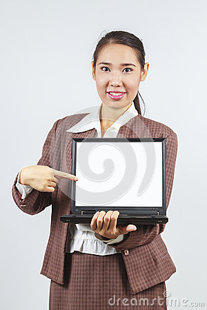 Asian woman pointing at her laptop