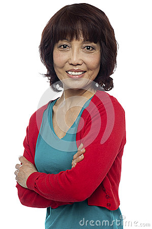 Asian woman posing with her arms crossed