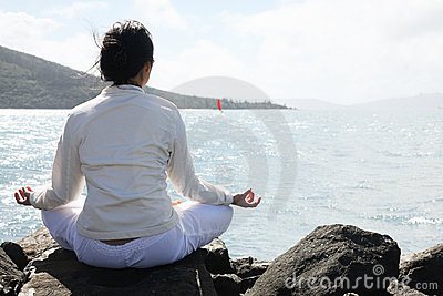 Asian woman practices Yoga