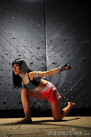 Asian Woman Practising Muay Thai Boxing