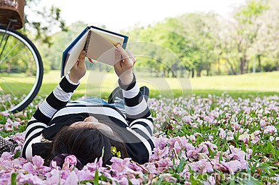 Asian woman reading booklet