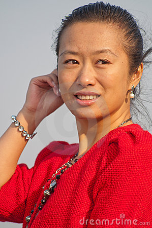 Asian woman in red coat