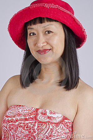 Asian Woman in Red Hat and Top