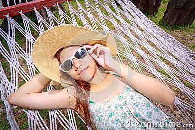 Asian woman relaxing on the beds beside garden