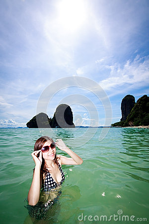 Asian woman relaxing on the sea