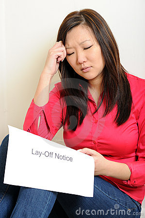 Asian woman sad over Lay-Of notice