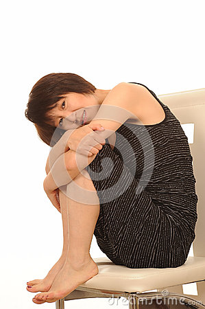 Asian woman sat on chair