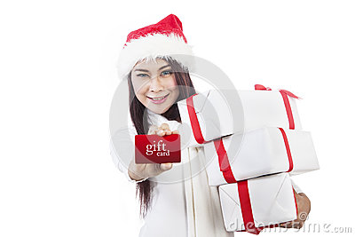 Asian woman showing gift card and christmas boxes