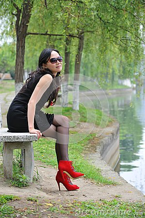Asian woman sit in Chair