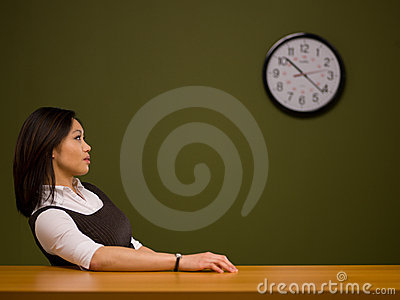 An asian woman sitting at a desk