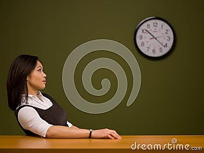 An asian woman sitting at a desk