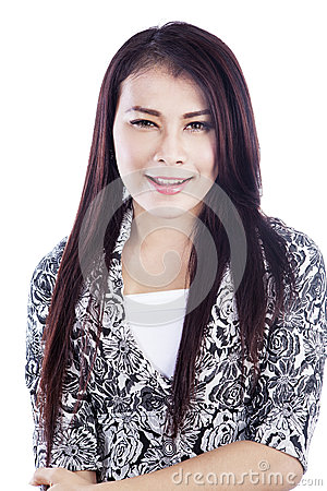 Asian woman smiling isolated over white