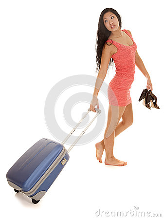 Asian woman suitcase look back