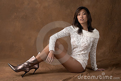 Asian woman in sweater and boots