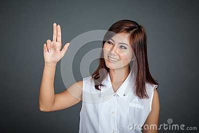 Asian woman touching the screen with two fingers