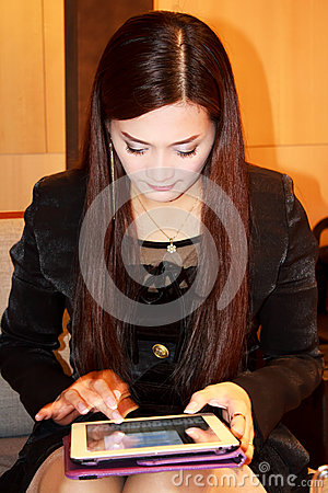 Asian woman using ipad