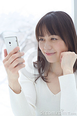 Asian woman using a smart phone