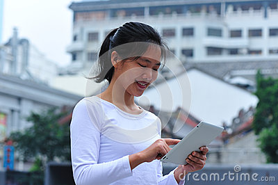 Asian woman using tablet