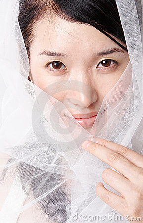 Asian woman in veil