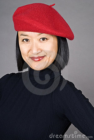 Asian Woman Wearing a Red Beret